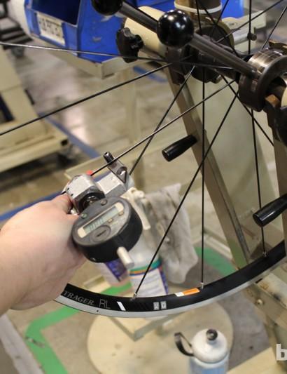 Spoke tension is one of many final checks on each wheel