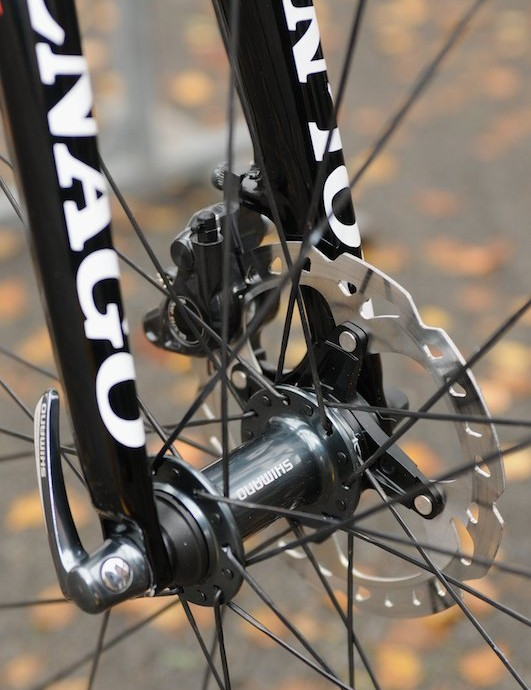 These unnamed Ultegra-coloured Shimano disc hubs use 28 J-bend spokes, and the mechanic obviously prefers to position the quick release lever on the right side