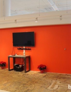A set of bleachers serves as the company meeting room, and faces this wall painted a color that, in the minds of many cyclists, Strava now owns