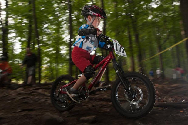 If your budding trail shredder wants something capable of keeping up with you on singletrack, there are a handful of companies that produce pint-sized bicycles that can truly be called mountain bikes