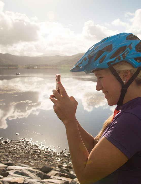 Hannah Barnes stops to take a snap shot on the way to Cape Wrath for the video NorthWest