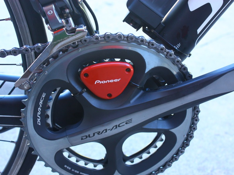 The Pioneer system is an add-on to existing Shimano Dura-Ace cranks. It is ANT+, but the system can be set for either the Pioneer head unit or other head units such as Garmins. While the varying color options are a nice touch, the zip-tied-on hardware is not