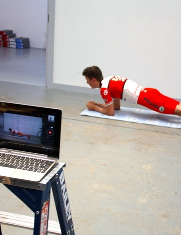 Robbie Hucker executes a basic plank to build core strength