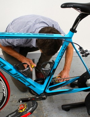 Ken Ballhause makes some small adjustments to accommodate Hucker's cleat position