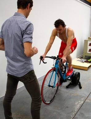 Bike fit technician Ken Ballhause inspects Wouter Wippert's initial bike set up