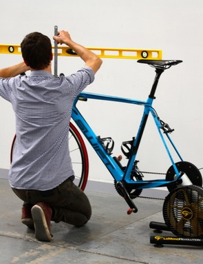 Ken Ballhause checks the difference between handlebar and saddle height on Lachie Norris' rig