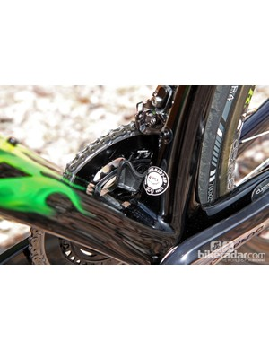 A seat tube-mounted chain catcher is built into the Trek Madone's frame design