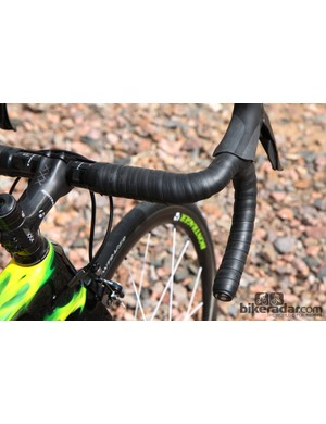 We opted for a set of Bontrager Race X Lite IsoZone carbon fiber bars, which come with foam pads that are affixed underneath the tape to help damp vibration. Guess what - it works