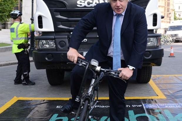 London mayor Boris Johnson poses at an HGV safety briefing