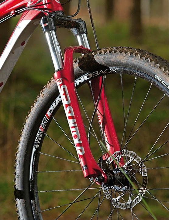 The clattery Suntour fork works okay on smooth trails but feels harsh at speed