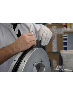 Building a wheel from scratch is a labour-intensive process that typically takes around 7.5 man hours