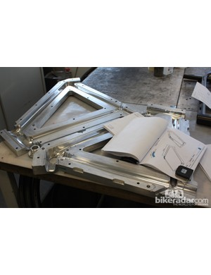 A plysheet sits on top of two halves of a mould for the front triangle of a frame