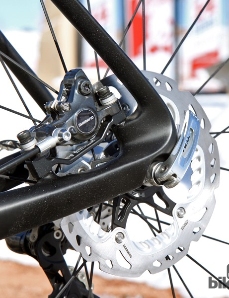 The rear disc brake is mounted to the chain stay where it's well-protected. Trek specs 160mm-diameter rotors but 140mm ones will fit at both ends