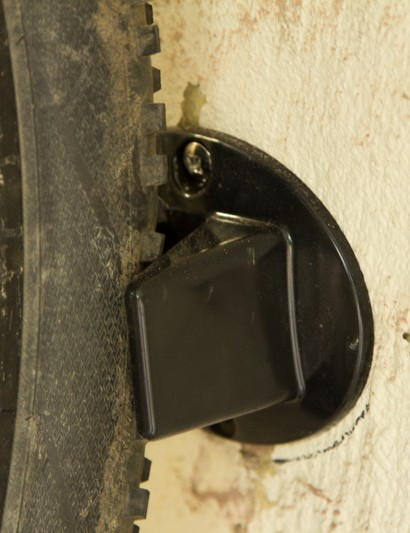 A rear wheel protector is provided to prevent wall damage and to allow for easier swinging