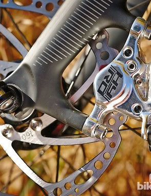 The cable-operated hydraulic TRP Hy/Rd brakes are excellent