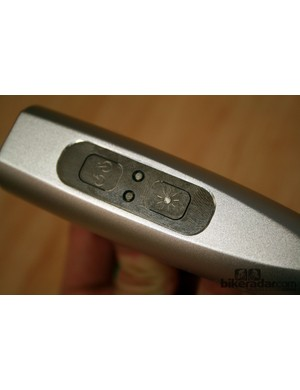 The LED light and laser functions are controlled independently by two separate buttons