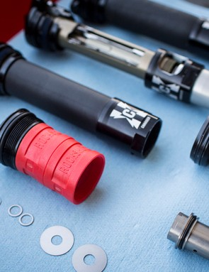 The RockShox Pike suspension fork uses red volume spacers, dubbed Bottomless Tokens, to adjust the