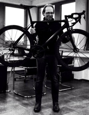 Markus Storck is holding a bike that weighs 5.5kg and costs £14,999