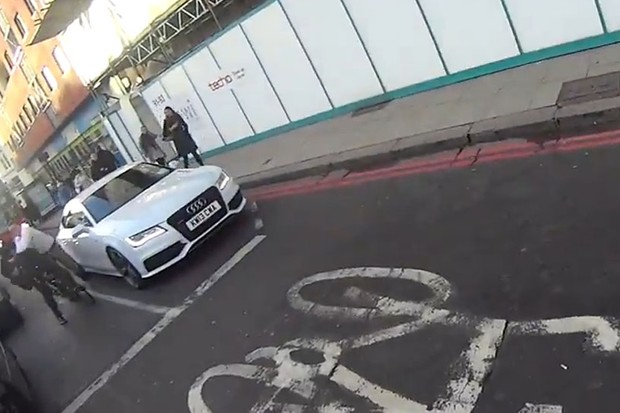 Helmet-cam cyclist catches a driver punching another cyclist