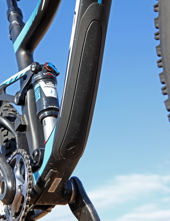 The down tube is protected by a burly rubber guard
