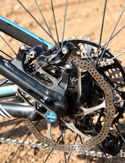 The post mount rear brake caliper tabs are sized for 160mm rotors. A DT Swiss RWS 142x12mm through-axle skewer keeps things tied together out back