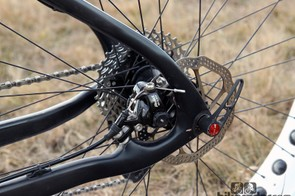 The rear brake caliper is tucked away inside the rear triangle. The caliper mounting bolts (and in this case, the cable clamp bolt) can be hard to access, though