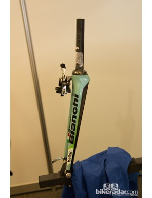 A lone team Belkin fork sits in the stand – a big enough crash can mean an entire frame swap is needed