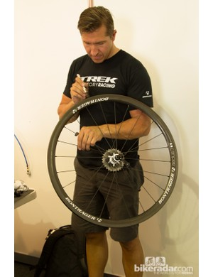 A Trek Factory Racing mechanic prepares a rim for a new tyre