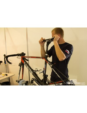 The frame mount stands used allow the mechanics to dial measurements and adjust saddles – two things that are far more difficult with tube clamp style workstands