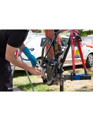 Daily cleaning is the first task for mechanics when they return from the race stage