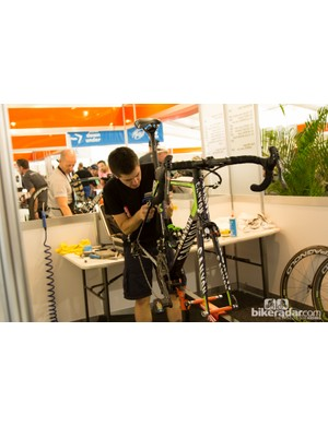 The mechanic bays at Tour Down Under are like little office cubicles. All mechanics work next to each other in front of the public eye