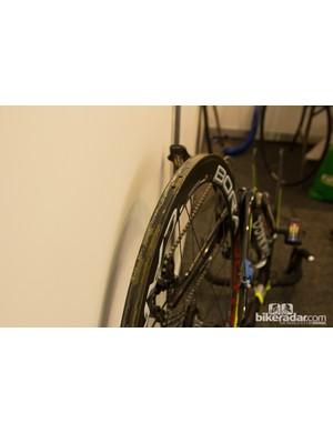 Europcar make do with an upside-down bike to hold a recently glued rim