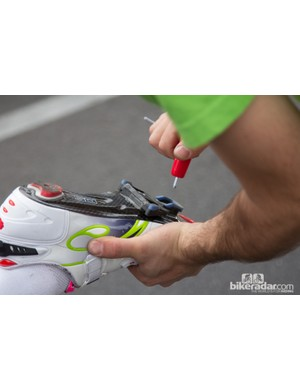 Lampre-Merida rider Diego Ulissi receives some last minute cleat adjustments before going onto win the day's stage into Sterling