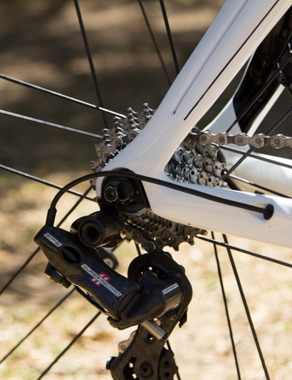 The rear derailleur wire is routed through the chainstay