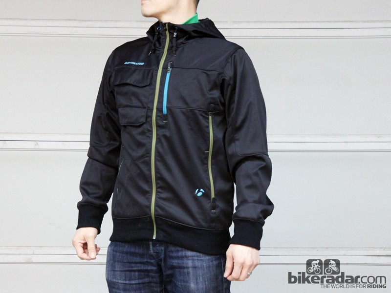 The Bontrager Rhythm Softshell Hoodie jacket features a water- and wind-resistant softshell exterior with a hood big enough for helmets and enough room for insulating layers