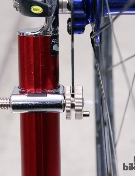 Slide the indicator arm up and use the built-in slot to help true warped disc rotors