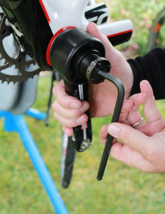 The tool is reversed for removing the crank