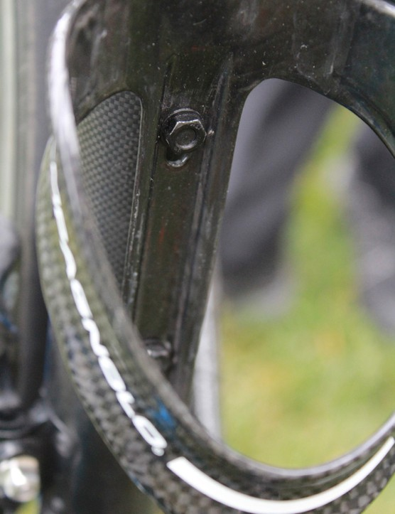 Then, water-bottle cages are secured onto the battery screws with nuts