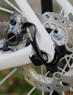 Shimano 140mm Ice Tech rotors, and the rear caliper, mounted between the stays