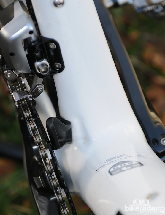 Trek's tidy proprietry chain catcher neatly fits on the side of the seat tube