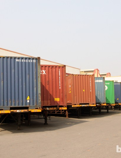 Scores of containers are lined up in the main shipping and receiving area. There's an immense amount of raw and finished goods that passes through here