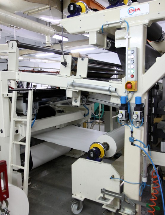 Backing paper is automatically applied as the raw carbon sheets emerge from the resin applicator