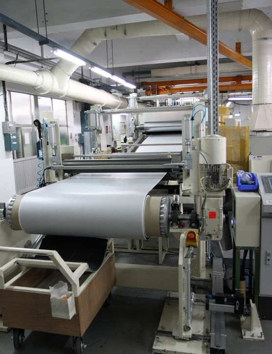 The finished pre-preg sheets are then rolled on to huge cardboard tubes for storage