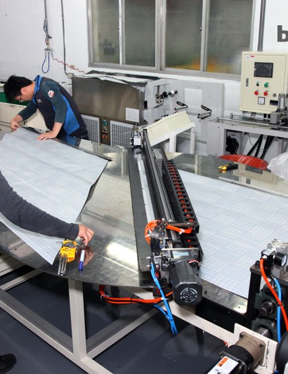 Unidirectional sheets are cut with a computer-controlled blade before being rearranged into various bias-ply sheets