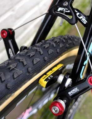 The rear brake bridge is well above Dugast's finest for maximum mud clearance