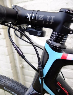 A Fizik stem, Di2 control box and hydraulic hose connectors for the Shimano brakes to ease servicing