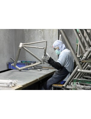 Some welds are left raw while others are sanded down, depending on the specifications outlined in the drawing