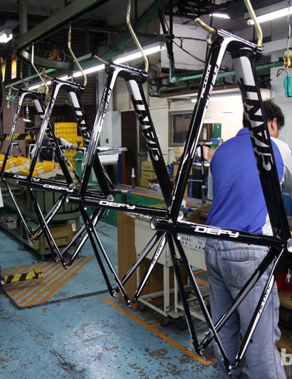 Completed frames travel on hooks to the first stage of assembly