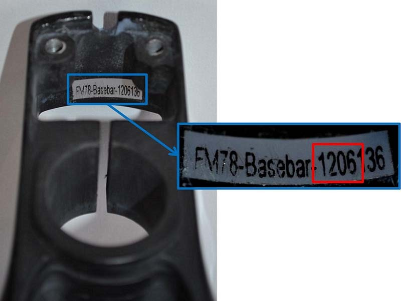 The serial number and date code are inside the base bar on the rear wall