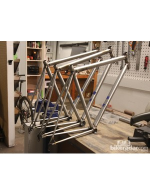 A trio of freshly welded steel frames waiting for their braze-ons and bridges